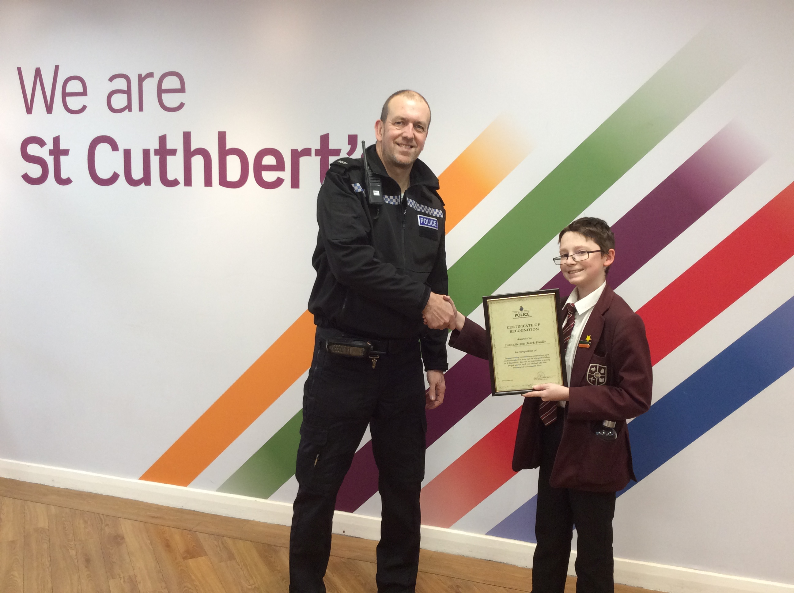 PC Pender receiving his certificate from Leon